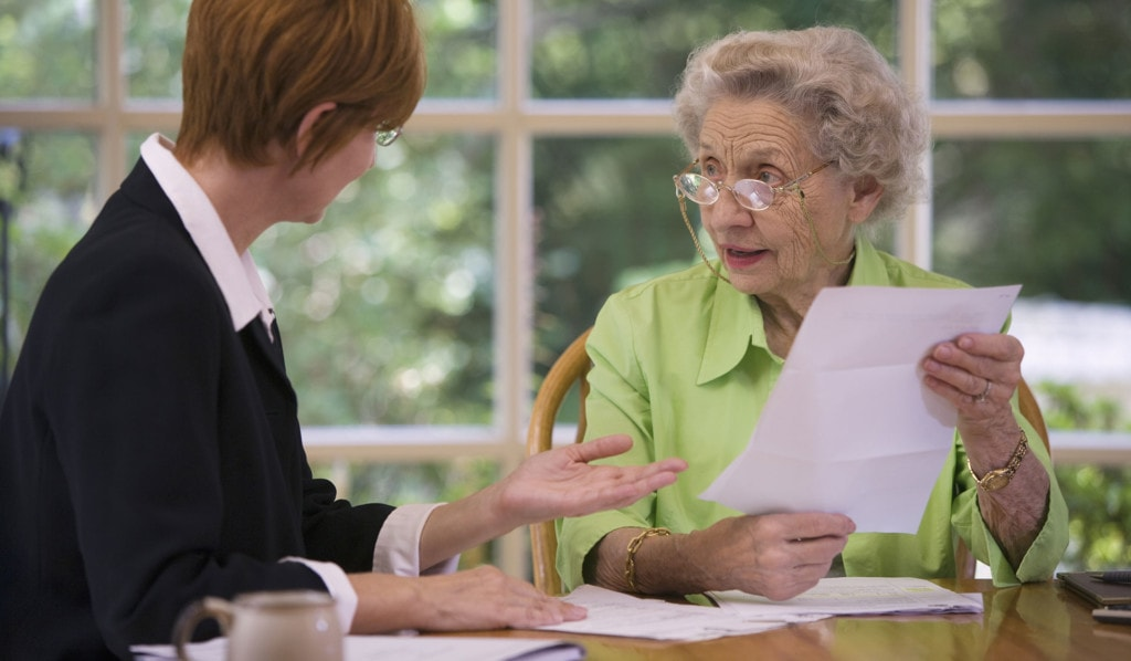 Photo of older woman consulting woman on legal matters.