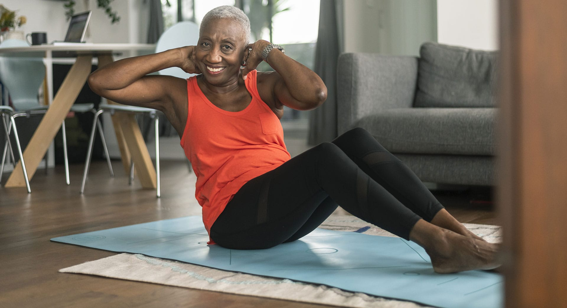 Photo of woman doing exercises on mat.