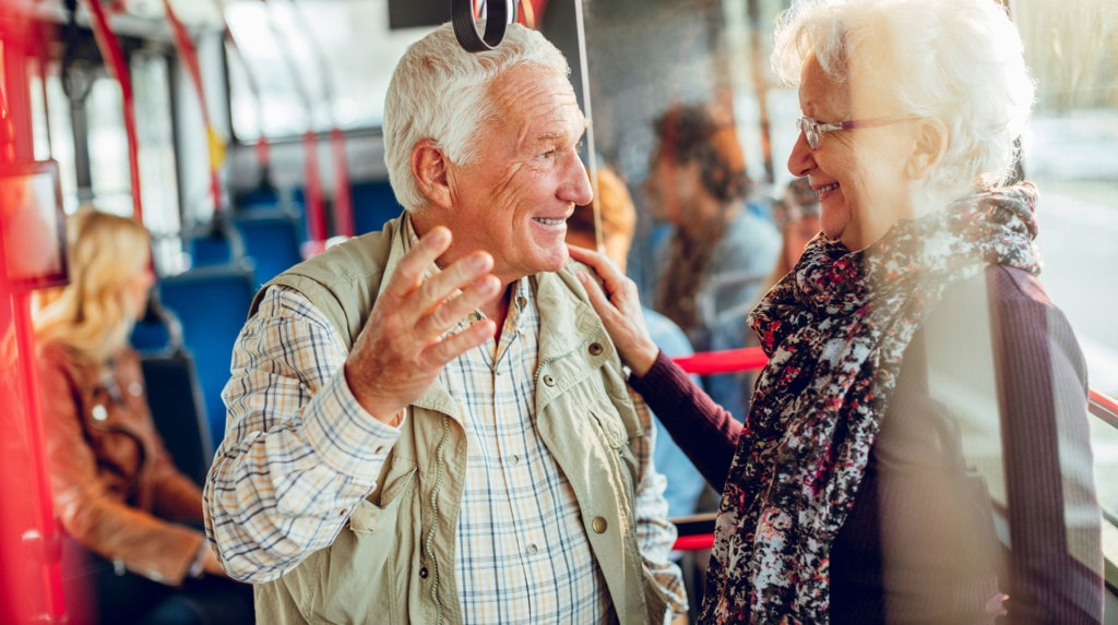 Photo of elderly couple on bus.