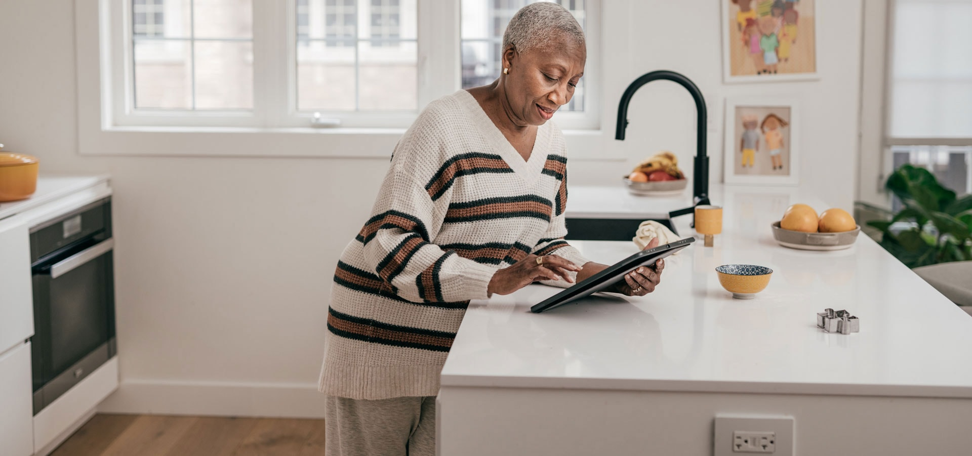 Photo of elderly black woman on tablet device.
