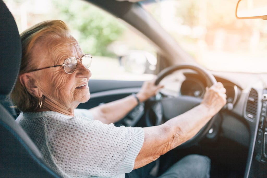 Photo of elderly woman driving.